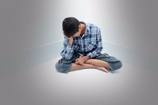 Niño adolescente triste
